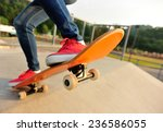 young woman legs skateboarding... | Shutterstock . vector #236586055