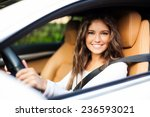 young woman driving her car | Shutterstock . vector #236593021