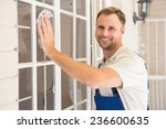 Handyman Cleaning The Window...