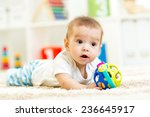 little boy playing with toy... | Shutterstock . vector #236645917