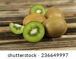 Kiwi Fruit On Brown Wooden...