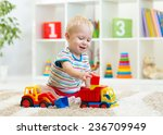 kid boy toddler playing toys at ... | Shutterstock . vector #236709949