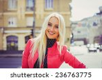 smiling beautiful blond woman... | Shutterstock . vector #236763775