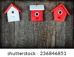three birdhouses painted with... | Shutterstock . vector #236846851