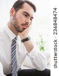 worried businessman sitting on... | Shutterstock . vector #236848474