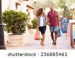 couple walking along street... | Shutterstock . vector #236885461