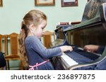 Cute Little Girl Playing Grand...