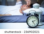 asian man in bed suffering... | Shutterstock . vector #236902021