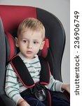 little boy in a a car seat | Shutterstock . vector #236906749