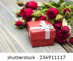 red roses  and gift box on a... | Shutterstock . vector #236911117