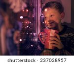 Little Boy With Big Cup Of Hot...