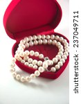 romantic gift into jewelry box   Shutterstock . vector #237049711