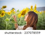 beautiful woman enjoys blooming ... | Shutterstock . vector #237078559