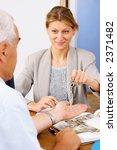real estate agent handing keys... | Shutterstock . vector #2371482