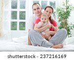family at home on bed | Shutterstock . vector #237216169
