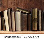 old books on wooden shelf.  | Shutterstock . vector #237225775