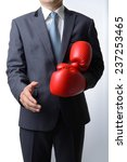 businessman take off red boxing ...   Shutterstock . vector #237253465