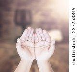 hands of man praying over... | Shutterstock . vector #237253849