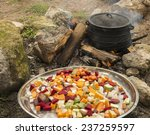 cooking in cauldron on burning... | Shutterstock . vector #237259597