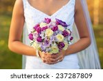 bride holding wedding bouquet  | Shutterstock . vector #237287809