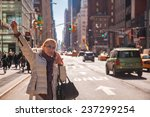 girl calling taxi cab in new... | Shutterstock . vector #237299254