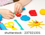 child hands playing with...   Shutterstock . vector #237321331