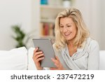 middle aged woman reading a...   Shutterstock . vector #237472219