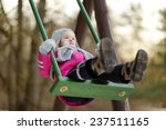 Adorable Girl Having Fun On A...