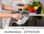 Female Hands Holding Saucepan ...