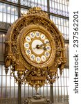 Small photo of PARIS - AUGUST 21, 2013: Golden clock of the museum D'Orsay in Paris, France. Musee d'Orsay has the largest collection of impressionist and post-impressionist paintings in the world.