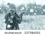 girl portrait winter snowfall... | Shutterstock . vector #237586501