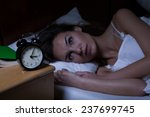 Woman With Insomnia Lying In...