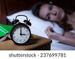 Alarm Clock On Night Table...