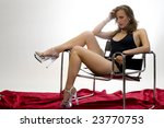 Leggy Model Draped Across a Modernist Chair. - stock photo