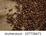 coffee beans on a burlap. | Shutterstock . vector #237728671