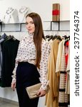 fashionable young woman in a... | Shutterstock . vector #237764374