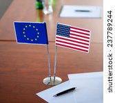 table with two flag usa and eu | Shutterstock . vector #237789244
