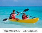Father And Son Kayaking At...
