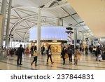 OSAKA,JAPAN - NOVEMBER 12, 2014; Travelers and shops at Kansai International Airport. This is the Osaka International Airport. November 12, 2014 Osaka, Japan - stock photo