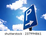 Parking Sign With Blue Sky And...