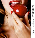 Sexy young pretty woman / model / girl / student / businesswoman / secretary with pink lips, vintage / retro is eating an apple / lips / seductive - closeup - stock photo