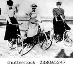women riding bicycles 1900 | Shutterstock . vector #238065247