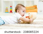 funny baby boy lying with plush ... | Shutterstock . vector #238085224