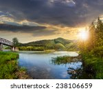 collage view on bridge through the forest river near village in mountains in sunset light - stock photo