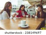 three friends having a coffee... | Shutterstock . vector #238149697