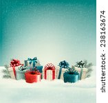christmas gift boxes in snow.... | Shutterstock .eps vector #238163674