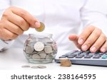 Businessman Putting Money Coin...