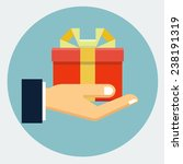 gift box in hand  | Shutterstock .eps vector #238191319