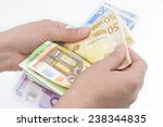 close up of hands counting euro ...   Shutterstock . vector #238344835