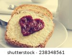 jam forming a heart on a toast  ... | Shutterstock . vector #238348561